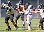 Palos Verdes, CA 09/25/15 - Chris Ghaly (Peninsula #75), Chris Ghaly (Peninsula #75), Daniel Schubert (Peninsula #18) and \l56\ in action during the Lawndale - Palos Verdes Peninsula Varsity football game at Peninsula High School.