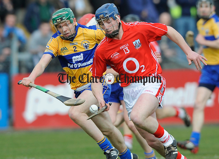 Clare's Conor Mc Mahon gives chase to Cork's Pat Horgan during their NHL game at Cusack Park. Photograph by John Kelly.