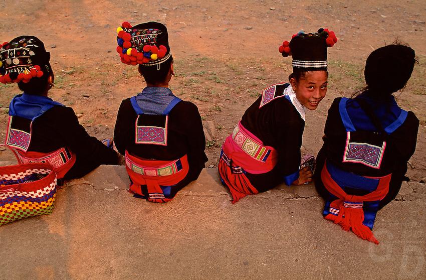 Muang Hill Tribe Girls in full festival dress during the water festival in Luang Prabang, Laos