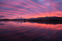 Spectacular pink sunrise reflection on Loch Ba, Rannoch Moor, Highland, Scotland