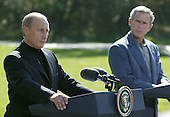 United States President George W. Bush, right, and President Vladimir Putin of Russia, left, speak during a news conference September 27, 2003 at Camp David, Maryland. Putin arrived September 26 after attending official meetings at the United Nations in New York.  .Credit: Mark Wilson - Pool via CNP..