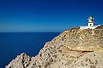 A lighthouse sits on the edge of the caldera in Santorini, Greece