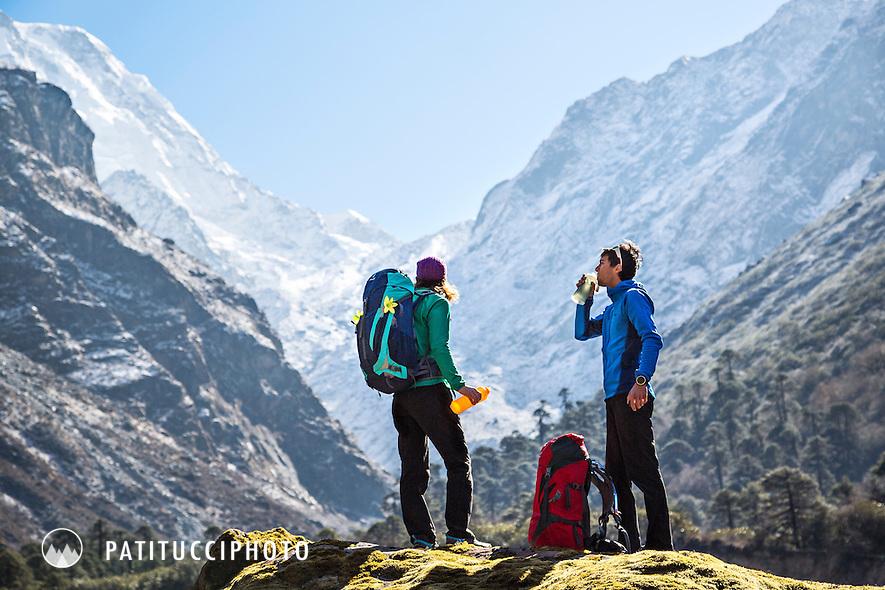 Trekkers in the Inkhu Khola river valley, on the Mera Peak Trail, between Kote and Thangnak, Nepal Himalaya.