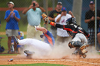 New York Mets left fielder Tim Tebow (15) is tagged out at home by catcher Pablo Garcia during an Instructional League game against the Miami Marlins on September 29, 2016 at the Port St. Lucie Training Complex in Port St. Lucie, Florida.  (Mike Janes/Four Seam Images)
