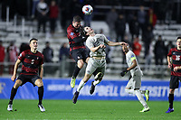 CARY, NC - DECEMBER 13: Gabe Segal #17 of Stanford University heads the ball over Paul Rothrock #3 of Georgetown University during a game between Stanford and Georgetown at Sahlen's Stadium at WakeMed Soccer Park on December 13, 2019 in Cary, North Carolina.
