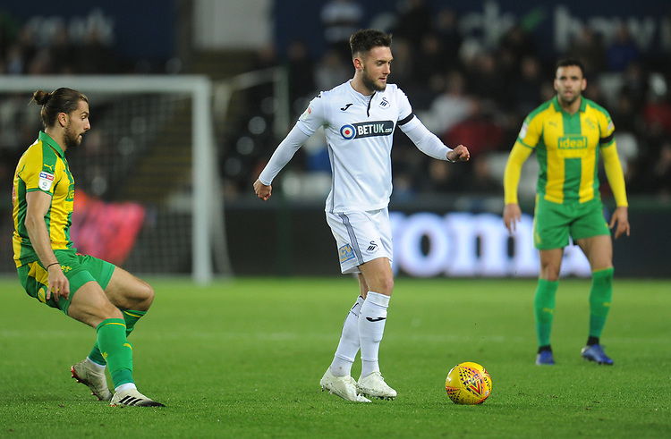 Swansea City's Matt Grimes under pressure from West Bromwich Albion's Jay Rodriguez<br /> <br /> Photographer Kevin Barnes/CameraSport<br /> <br /> The EFL Sky Bet Championship - Swansea City v West Bromwich Albion - Wednesday 28th November 2018 - Liberty Stadium - Swansea<br /> <br /> World Copyright &copy; 2018 CameraSport. All rights reserved. 43 Linden Ave. Countesthorpe. Leicester. England. LE8 5PG - Tel: +44 (0) 116 277 4147 - admin@camerasport.com - www.camerasport.com