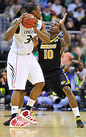 Dion Dixon of the Bearcats looks to drive past Ricardo Ratliffe of the Tigers. Cincinnati defeated Missouri 78-63 during the NCAA tournament at the Verizon Center in Washington, D.C. on Thursday, March 17, 2011. Alan P. Santos/DC Sports Box