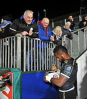 Niko Matawalu of Bath Rugby signs an autograph after the match. European Rugby Champions Cup match, between Bath Rugby and Leinster Rugby on November 21, 2015 at the Recreation Ground in Bath, England. Photo by: Patrick Khachfe / Onside Images