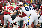 Wisconsin Badgers offensive lineman Tyler Biadasz (61) blocks during an NCAA College Big Ten Conference football game against the Michigan Wolverines Saturday, November 18, 2017, in Madison, Wis. The Badgers won 24-10. (Photo by David Stluka)