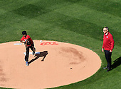 Washington Baseball Academy Youth Player Duane Dargin throws out the ceremonial first pitch under the watchful eye of Major League Baseball Commissioner Robert D. Manfred Jr. prior to the Opening Day game pitting the New York Mets against the Washington Nationals at Nationals Park in Washington, D.C. on Monday, April 6, 2015.  <br /> Credit: Ron Sachs / CNP<br /> (RESTRICTION: NO New York or New Jersey Newspapers or newspapers within a 75 mile radius of New York City)