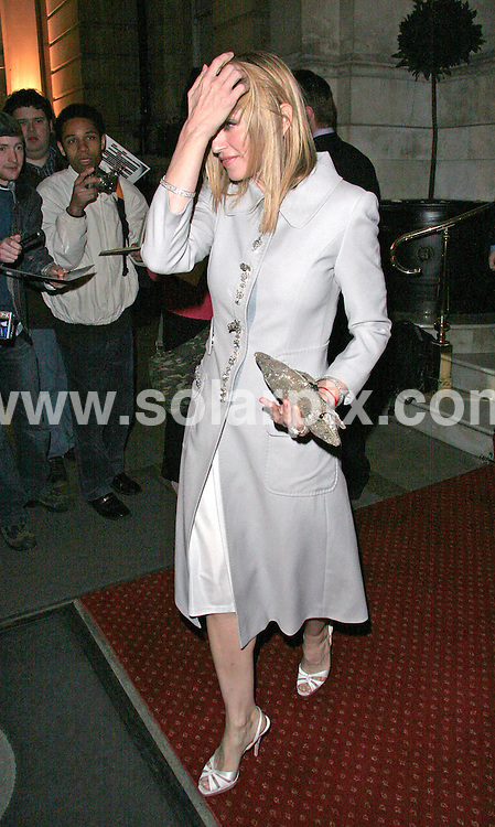 **ALL ROUND PICTURES FROM SOLARPIX.COM**.**WORLDWIDE SYNDICATION RIGHTS**.Has Madonna and Guy Ritchie had the argument to end all arguments? Madonna was spotted during the day on Tuesday 13th March at her gym looking extremely upset with a graze on her forehead. Later that evening at the Langham Hotel in west London attending a H&M fashion event, she had styled her hair to cover the cut on her head and was not wearing her wedding ring. ..JOB REF:    3501   SSD     DATE: 13.03.07.**MUST CREDIT SOLARPIX.COM OR DOUBLE FEE WILL BE CHARGED* *UNDER NO CIRCUMSTANCES IS THIS IMAGE TO BE REPRODUCED FOR ANY ONLINE EDITION WITHOUT PRIOR PERMISSION*
