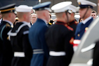 Former President George W. Bush watches as the flag-draped casket of former President George H.W. Bush is carried by a joint services military honor guard to Special Air Mission 41, Wednesday, Dec. 5, 2018, at Andrews Air Force Base, Md.<br /> Credit: Alex Brandon / Pool via CNP / MediaPunch