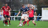 Freddie Clarke of London Scottish & Brendan Cope in action during the Greene King IPA Championship match between London Scottish Football Club and Jersey at Richmond Athletic Ground, Richmond, United Kingdom on 7 November 2015. Photo by Andy Rowland.