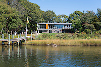 The exterior of a contemporary riverside home in Westport Massachusetts, USA