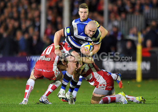 Carl Fearns takes on the Gloucester defence. Aviva Premiership match, between Bath Rugby and Gloucester Rugby on October 25, 2013 at the Recreation Ground in Bath, England. Photo by: Patrick Khachfe / Onside Images