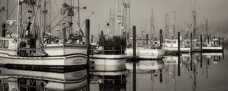 Boats with fog at Newport Harbor. Oregon