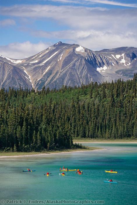 Kayakers on Como lake, British Columbia, Canada