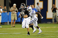 1 October 2011:  FIU tight end Colt Anderson (15) is pursued by Duke safety Walt Canty (4) after a reception in the third quarter as the Duke University Blue Devils defeated the FIU Golden Panthers, 31-27, at FIU Stadium in Miami, Florida.