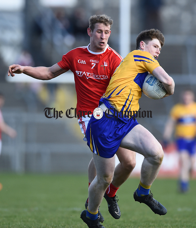 Sean O Donoghue of Clare in action against Anthony Williams of Louth during their national League game in Cusack Park. Photograph by John Kelly.