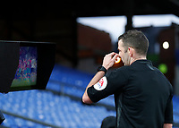 5th January 2020; Selhurst Park, London, England; English FA Cup Football, Crystal Palace versus Derby County; Referee Michael Oliver checking the touchline VAR monitor before giving a red card to Luka Milivojevic of Crystal Palace after Luka Milivojevic of Crystal Palace headbutts Tom Huddlestone of Derby County - Strictly Editorial Use Only. No use with unauthorized audio, video, data, fixture lists, club/league logos or 'live' services. Online in-match use limited to 120 images, no video emulation. No use in betting, games or single club/league/player publications