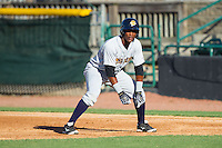 Miguel Andujar (5) of the Charleston RiverDogs takes his lead off of first base against the Hickory Crawdads at L.P. Frans Stadium on May 24, 2014 in Hickory, North Carolina.  The Crawdads defeated the RiverDogs 7-3.  (Brian Westerholt/Four Seam Images)