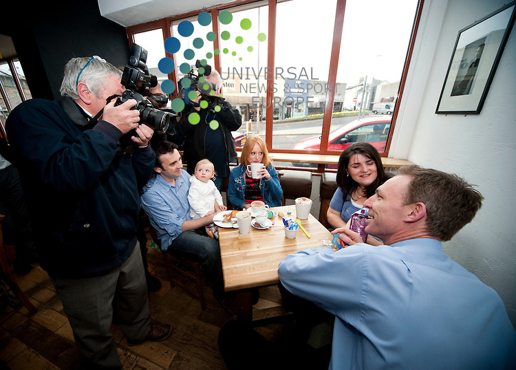 Jim Murphy (Blue shirt) with Emma (red hair) and Gordon McKinnes with baby Lucy, Shona Lewindon (dark hair)  and baby Shane. Scottish Secretary Jim Murphy chatted with families over coffee and tea to highlight Labour's Policies including their stance on Tax credits. ..Beanscene, 1-3 Helena Place, Busby Road, Clakston, Glasgow, Scotland G76 7RB. Picture: Euan Anderson/Universal News And Sport (Scotland) 26th April 2010.