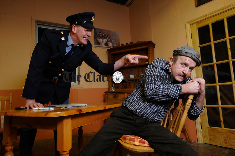 "Billy Merriman as Guard Nolan and Gregory Ryne as Charlie Mullen in rehearsals for the Mullagh Entire Players production of ""Love Thy Neighbour"" which runs in Mullagh Hall on Friday 20th, Sunday 22nd and Saturday 28th of February at 8.30p.m. nightly. Photograph by John Kelly."