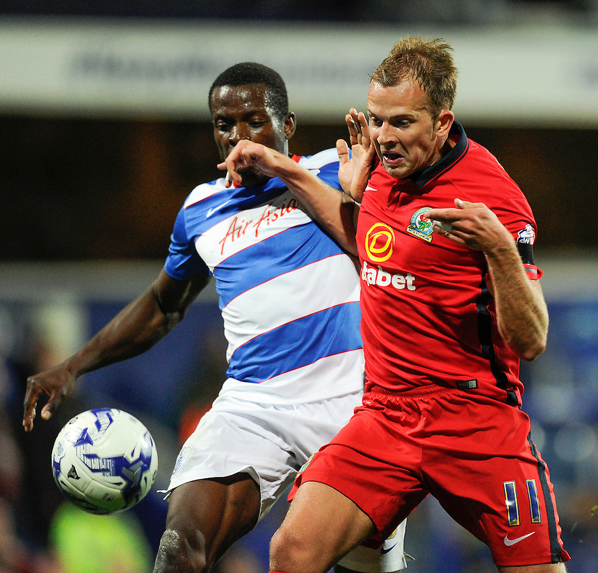 Blackburn Rovers' Jordan Rhodes holds off the challenge from Queens Park Rangers' Nedum Onuoha to score the 2nd goal<br /> <br /> Photographer Ashley Western/CameraSport<br /> <br /> Football - The Football League Sky Bet Championship - Queens Park Rangers v Blackburn Rovers - Wednesday 16th September 2015 - Loftus Road - London <br /> <br /> &copy; CameraSport - 43 Linden Ave. Countesthorpe. Leicester. England. LE8 5PG - Tel: +44 (0) 116 277 4147 - admin@camerasport.com - www.camerasport.com