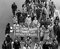 Combahee river collective with banner marching on Massachusetts Avenue at memorial march for murdered women of color 4.1.79 Boston MA
