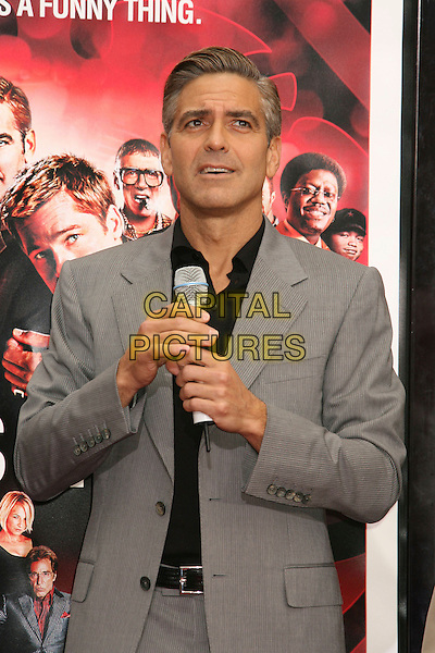 """GEORGE CLOONEY.""""Ocean's Thirteen"""" Handprint and Footprint Ceremony held  at Grauman's Chinese Theatre, Hollywood, California, USA..June 5th, 2007.half length grey gray microphone suit jacket .CAP/ADM/RE.©Russ Elliot/AdMedia/Capital Pictures"""