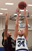 NWA Democrat-Gazette/CHARLIE KAIJO Rogers High School forward Ally Figenskau (34) and Siloam Springs High School center Emery Brown (31) reach for a rebound, during the Great 8 Tournament, Thursday, November 29, 2018 at King Arena at Rogers High School in Rogers.