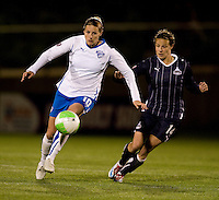 Sarah Huffman (14 of the Washington Freedom stays close to Kelly Smith (10) of the Boston Breakers at the Maryland SoccerPlex in Boyds, Maryland. The Washington Freedom tied the Boston Breakers, 0-0.