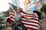 American fans at the Shibuya Crossing in Tokyo on Monday 6th July, 2015. Shibuya Crossing is often the scene of Japanese fan celebrations after team victories but today the only people celebrating were American supporters after the USA defeated Japan 5-2 in the final of the FIFA Women's Soccer World Cup. (Photo by Rodrigo Reyes Marin/AFLO)
