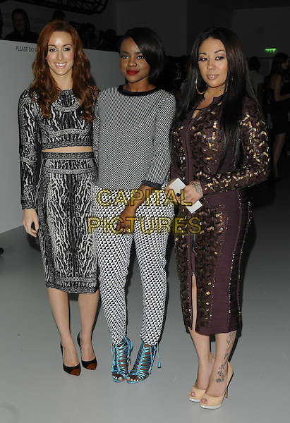 Siobhan Donaghy, Keisha Buchanan &amp; Mutya Buena of MKS<br /> attended the LFW s/s 2014 PPQ catwalk show, BFC Showspace, Somerset House, The Strand, London, England, UK, <br /> 13th September 2013.<br /> full length sugababes black white print patterned jumper trousers top skirt dress crop cropped midriff long sleeve brown gold blue sandals <br /> CAP/CAN<br /> &copy;Can Nguyen/Capital Pictures