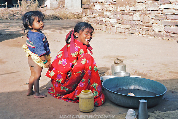 Helping with household chores in this remote rural village in Gujarat involves using as little water as possible.