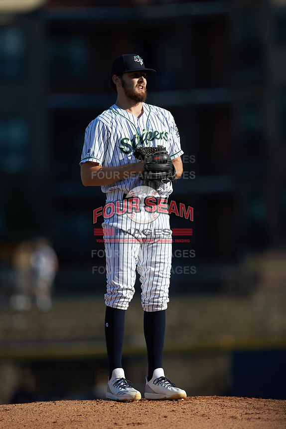 Gwinnett Stripers starting pitcher Ian Anderson (51) looks to his catcher for the sign against the Scranton/Wilkes-Barre RailRiders at Coolray Field on August 18, 2019 in Lawrenceville, Georgia. The RailRiders defeated the Stripers 9-3. (Brian Westerholt/Four Seam Images)
