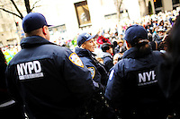 NYPD officers keep eye on pedestrians as they take part during the annual easter parade in Manhattan, New York, 03.27.2016. This annual tradition has been taking place in New York City for over 100 years, Photo by VIEWpress.