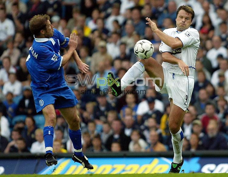 Pix, Shaun Flannery/SWpix. Barclaycard Premiership..Leeds United v Birmingham City, 20/9/2003..COPYRIGHT PICTURE>>SIMON WILKINSON>>01943 - 436649>>..Leeds Mark Viduka beats Birmingham's Jamie Clapham