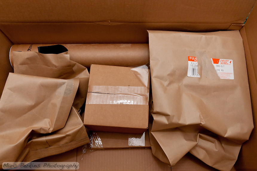 BWC Photo Imaging (http://www.bwc.net) packed the prints extremely well.  While the padding in the box was reused paper envelopes, they were surdy enough to keep everything in place.  And the two boxes were shrinkwrapped together.