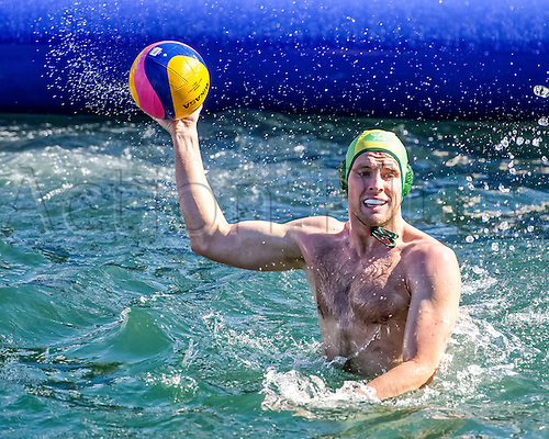 15.12.2015. Johnno Cotterill (#4) of Australia looks to pass the ball during Australia's 14-10 loss to Italy in the Mens Australia versus Italy International Water Polo match at Campbell's Cove in Sydney, Australia.