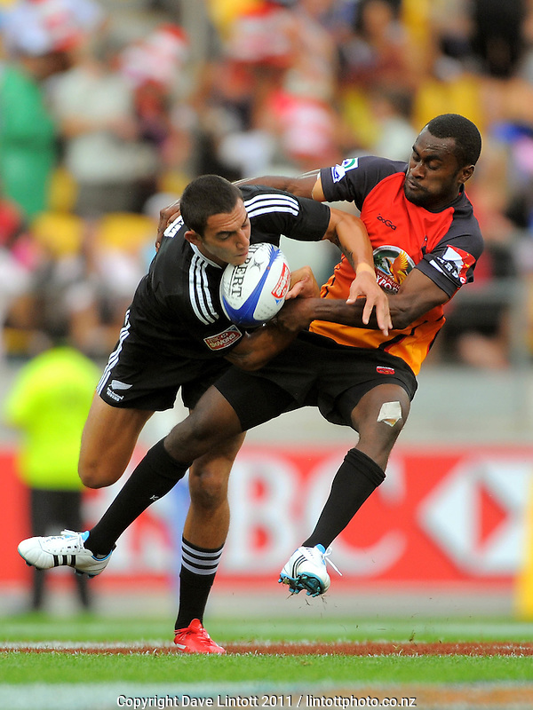 NZ's Bryce Heem is scragged by Papua New Guinea's Chris Kakah. IRB Wellington Sevens - Day One at Westpac Stadium, Wellington, New Zealand on Friday, 4 February 2011. Photo: Dave Lintott / lintottphoto.co.nz