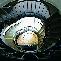 A view down the stairwell of a caracole staircase
