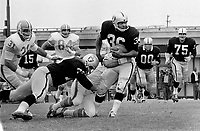 Oakland Raiders Clem Daniels with a block from Harry Schuh against the Houston Oilers...1966 playing at Frank Youell Field in downtown Oakland...(photo/Ron Riesterer)