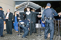 Attendees go through security as they arrive at the American Airlines Arrivals/Departures area at the MSNBC After Party at the United States Institute of Peace in Washington, DC. The party followed the annual White House Correspondents Association Dinner on Saturday, April 30, 2016. The party continued until about 3 AM on Sunday, May 1, 2016.