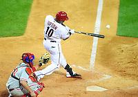 Apr. 26, 2011; Phoenix, AZ, USA; Arizona Diamondbacks outfielder Justin Upton hits an RBI single in the seventh inning against the Philadelphia Phillies at Chase Field. Mandatory Credit: Mark J. Rebilas-