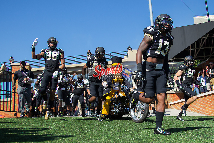 The Wake Forest Demon Deacons take the field prior to the game against the Army Black Knights at BB&T Field on September 20, 2014 in Winston-Salem, North Carolina.  The Demon Deacons defeated the Black Knights 24-21.  (Brian Westerholt/Sports On Film)