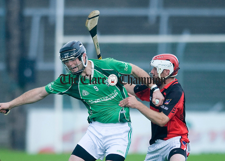 Patrick Minogue of Scariff attempts to break free from Raymond Cahill. Photograph by Declan Monaghan