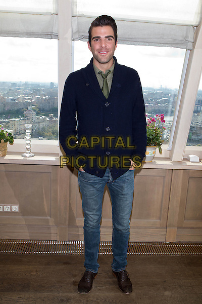 """Zachary Quinto.At the premiere of """"Margin Call"""",.Moscow, Russia, 27th September 2011..full length  green shirt tie blue cardigan  jeans .CAP/PER/SB.©SB/PersonaStars/Capital Pictures."""