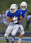 Columbia's Donavan Bieber (left) takes off after quarterback Nic Horner (right) handed him the ball. Columbia played Mascoutah on Saturday August 31, 2019 in a football game that was never started on Friday night due to bad storms.<br /> Tim Vizer/Special to STLhighschoolsports.com