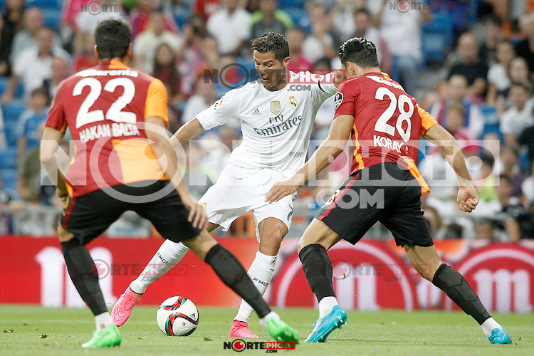 Real Madrid's Cristiano Ronaldo (c) and Galatasaray's Hakan Balta (l)and Koray Gunter during XXXVI Santiago Bernabeu Trophy. August 18,2015. (ALTERPHOTOS/Acero)